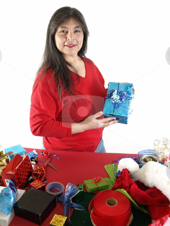 Gift Wrapped for You stock photo, An adult female wraps a gift with ribbons and bows. Over white. by Robert Gebbie