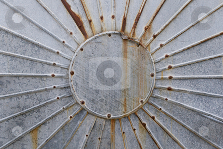 Circular metal container stock photo, The circular sun-like end of a big cylindrical metal container in a not so good condition by Anders Peter