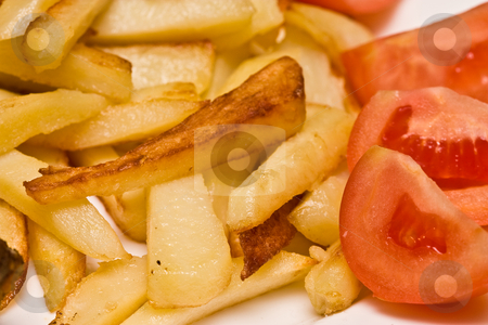 Fried potatoes stock photo, Food series: fried potatoes and fresh tomato by Gennady Kravetsky