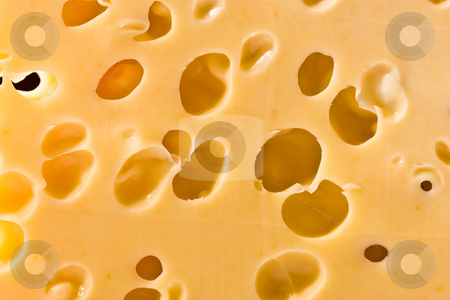Cheese texture stock photo, Macro picture of a cheese loaf with holes by Gennady Kravetsky