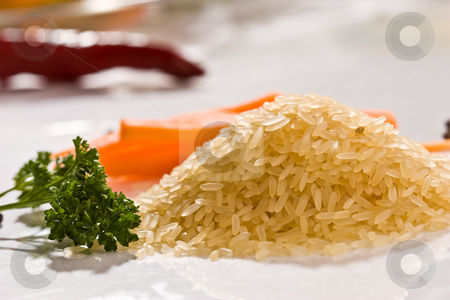 Rice stock photo, Hill of raw rice with vegetables 