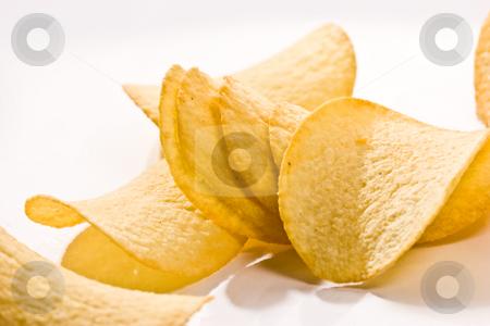 Potato chipson stock photo, Food series: golden potato chips over white by Gennady Kravetsky