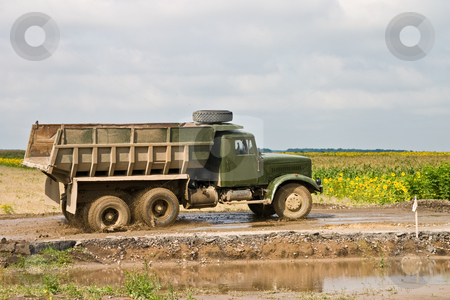 Dump-track stock photo, Building series: special road building vehicle on the parking by Gennady Kravetsky