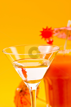 Cocktail stock photo, Drink series: tropical cocktail with juice on the yellow by Gennady Kravetsky