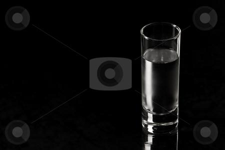 Vodka stock photo, Drink series: glass of Russian vodka over black by Gennady Kravetsky