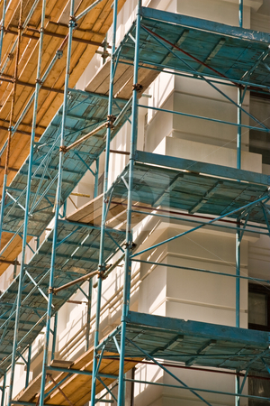 Under construction stock photo, Building series: new building under construction with falsework by Gennady Kravetsky