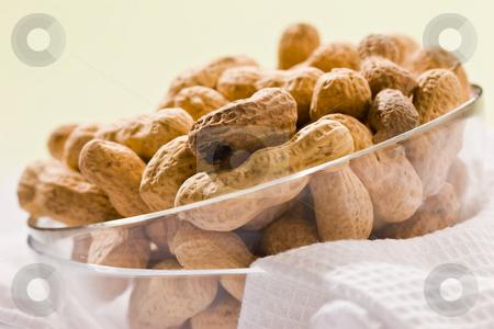 Peanut stock photo, Foodstuff theme:  peanut on the glassy bowl by Gennady Kravetsky