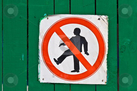 Sign stock photo, Warning Sign, prohibition symbol at the green fence by Gennady Kravetsky