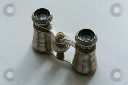 Opera Glasses stock photo, Mother-of-pearl opera glasses on white tile background by Andreas Brenner
