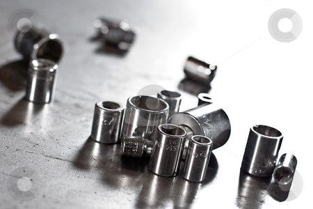 Worker tools - falnk sockets stock photo, Asssoretd dirty flank sockets on the workshop table by Gennady Kravetsky