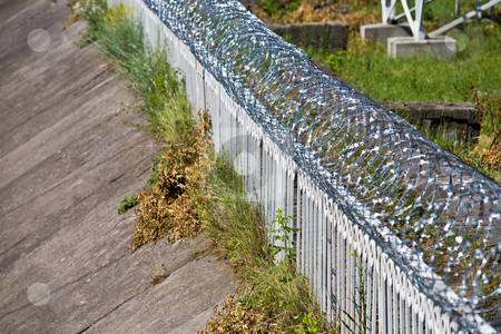 Barbed wire stock photo, Security series: barbed wire on the fence by Gennady Kravetsky