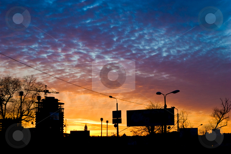 City sunset stock photo, City series: cloudy sunset on the modern city by Gennady Kravetsky
