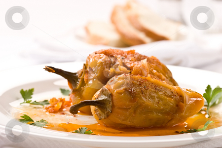 Stuffed peppers stock photo, Food series: stuffed peppers on the plate by Gennady Kravetsky
