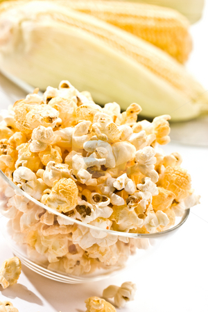 Popcorn stock photo, Food series: macro picture of popcorn on the bowl by Gennady Kravetsky