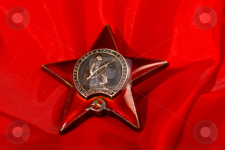 Medal stock photo, Honour series: star medal over red background by Gennady Kravetsky