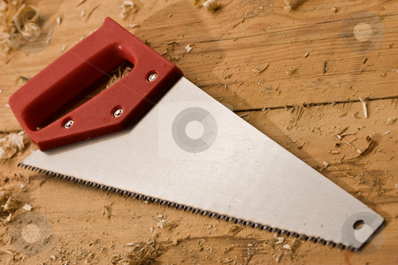 Saw stock photo, Tools series: saw with red plastic handle by Gennady Kravetsky
