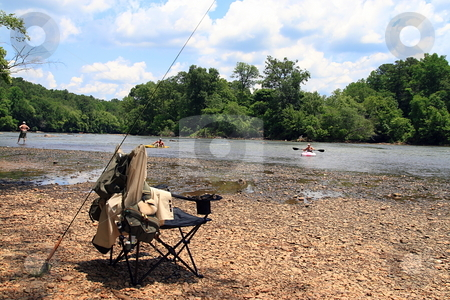 River Sports stock photo, People having fun at the river fishing and kayaking by Jack Schiffer