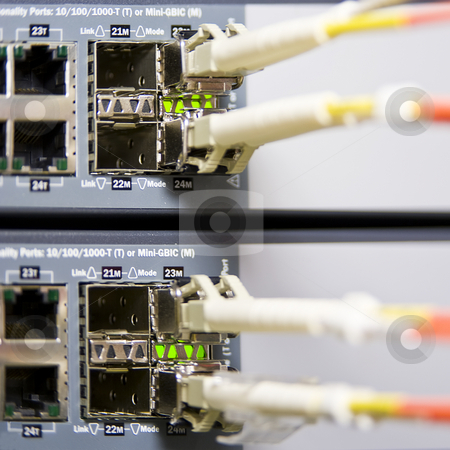Fiber optics stock photo, Fiber optics connectors on an internet server by Corepics VOF