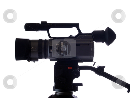 Side view of video camera mounted on tripod stock photo, Mid-range video camera mounted on tripod from the side by Jeff Cleveland