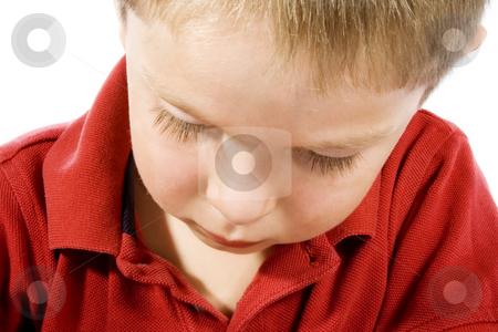 Sad Kid stock photo, Stock image of sad child over white background by iodrakon