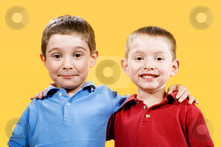 Brothers stock photo, Stock photo of two children over yellow background by iodrakon