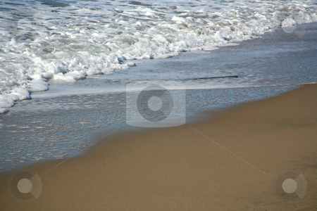 Shoreline stock photo, Smooth beach with small waves flowing on it by Stacy Barnett