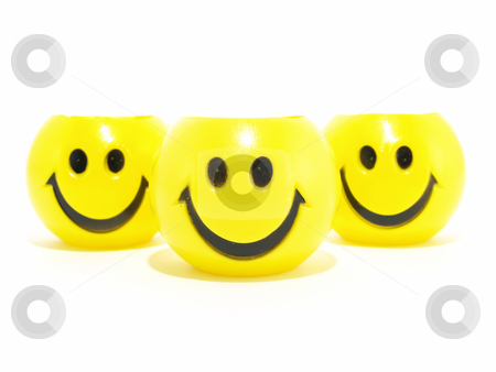 Smiles for You stock photo, Three yellow round smiles isolated on a white background. by Robert Gebbie