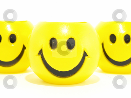 Yellow Smiles stock photo, Three yellow round smiles isolated on a white background. by Robert Gebbie