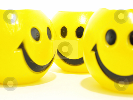 Smiling Faces stock photo, Three yellow round smiles isolated on a white background. by Robert Gebbie