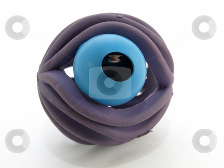 Peeking at You stock photo, Purple colored rubber ball with a bell inside. Isolated over a white background. by Robert Gebbie