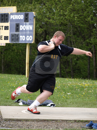 Shot Put Wind Up stock photo, Local Track and Field Event between rivals Columbia River High School and visiting team Hudson?? by Robert Gebbie