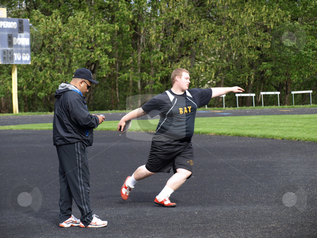 Practicing Discus Event stock photo, Local Track and Field Event between rivals Columbia River High School and visiting team Hudson?? by Robert Gebbie