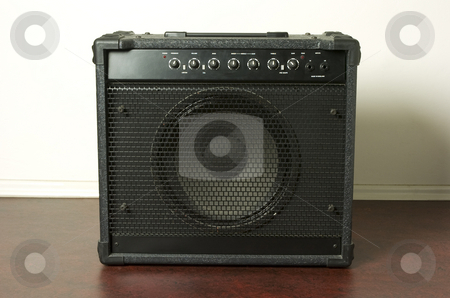 Bass amp stock photo, Bass guitar amplifier on red floor by Andreas Brenner