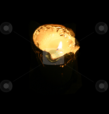 Silver candle in total darkness stock photo, Spot on the top of the candle by Reinhart Eo