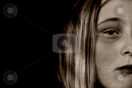 Child Abuse stock photo, A young girl looking sullen because of child abuse and depression, isolated against a black background by Richard Nelson