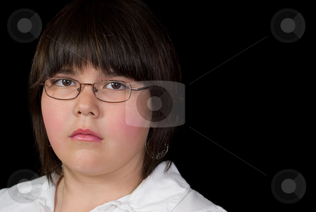Sad Girl stock photo, Closeup view of a sad girl who wears glasses, isolated against a black background by Richard Nelson