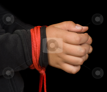 Child Abuse stock photo, Concept image of child abuse featuring a young girls hands tied with red rope by Richard Nelson