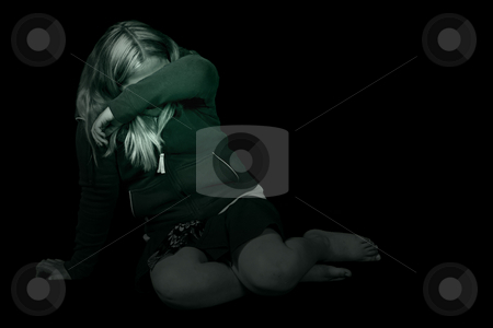 Abuse stock photo, Black and white image of a young girl cowering in a dark room, hiding from the abuse by Richard Nelson