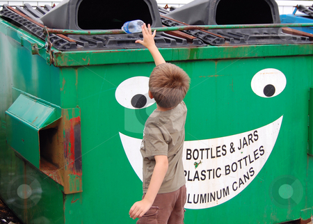 Young boy recycles stock photo,  by Heather Shelley