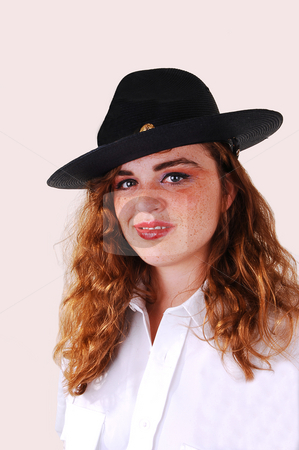 Girl security guard. stock photo, Pretty red haired woman security guard with the big black hat an white blouse on light gray background. by Horst Petzold