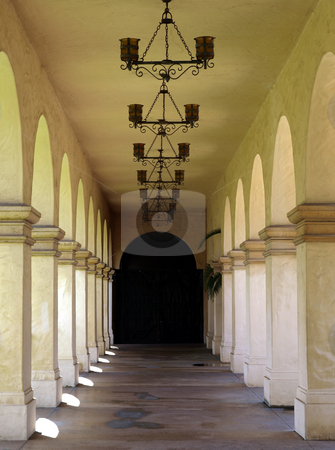 Spanish arched exterior walkway stock photo, An exterior mission style walkway with arched design by Jill Reid