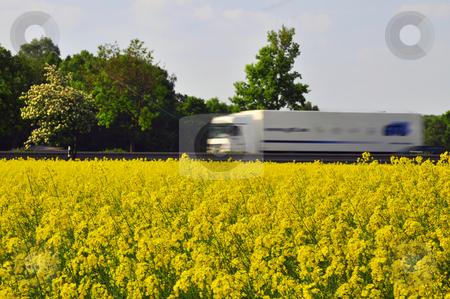 Bio Diesel stock photo, Truck passing a rape field as a symbol of alternative energy. by Nils Volkmer