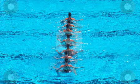 Synchronized Swimming Team stock photo, A seven women synchronized swimming team performing. by Denis Radovanovic