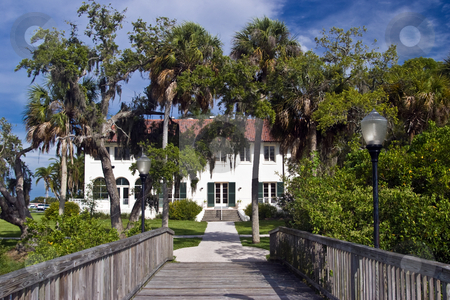 Edson Keith Estate stock photo, SARASOTA - 2008:  The Edson Keith estate as seen from the fishing pier on the south bank of Phillippi Creek.  The estate was built in 1916 and became the property of the people of Sarasota County in 1986.  It is listed in the National Register of Historic Places. by Steve Carroll