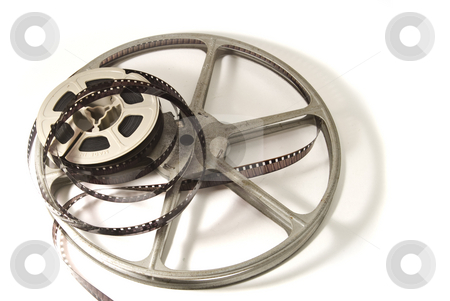 8mm Movie Film and reels stock photo, 8mm movie film on plastic real, with metal take-up reel.  Isolated on white backgroud. by Steve Carroll