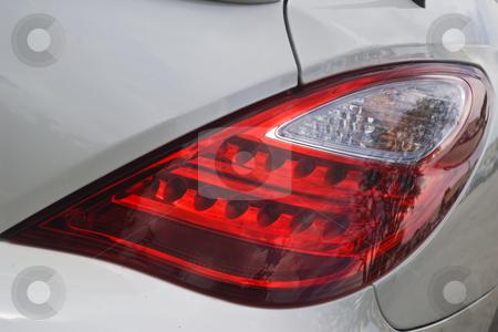 Automotive Tail Light stock photo, Tail light of a white sports car by Steve Carroll