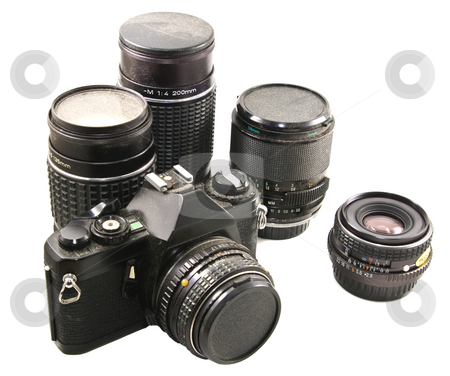 Old 35mm film camera & lenses stock photo, Dirty, disused and obsolete film camera with lenses by Steve Carroll