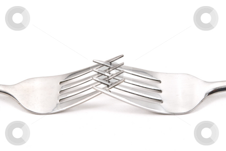 Two Forks stock photo, Two stainless steel forks on a white background. by Steve Carroll