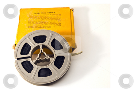 8mm Movie Film stock photo, 8mm movie film on plastic real, with yellow box.  Isolated on white backgroud. by Steve Carroll