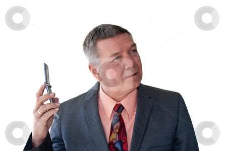 Portrait of Senior Businessman stock photo, Portrait of a senior businessman with cell phone, isolated on a white background. by Steve Carroll